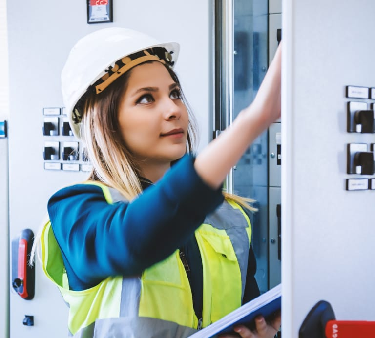 Women wearing high vis and hard hat