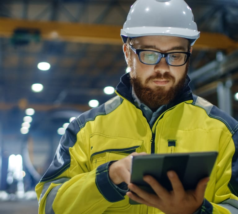 Man wearing high vis, goggles and hard hat